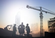 silhouette engineer in a building site over Blurred constructio